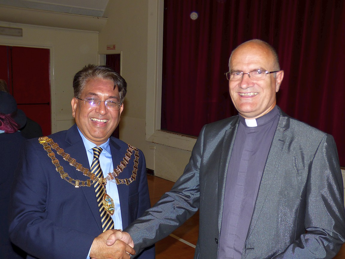 Vicar greeting the Mayor at the post-service reception