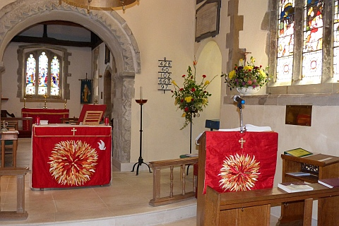 Photo: Our sanctuary beautifully decorated for Pentecost